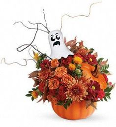Boo! It's a happy Halloween surprise when this classic pumpkin arrives,bursting with a beautiful fall bouquet.