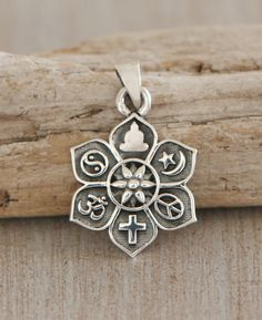 Detailed sterling silver lotus pendant shows relief symbols from the world's major religions on its petals. Made in Thailand.