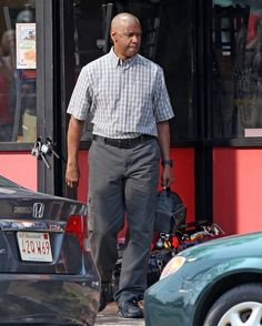 """Actor Denzel Washington waits to film a scene for """"The Equalizer"""" on June 25, 2013 in Chelsea, Massachusetts"""