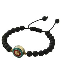 Om bracelet with black onyx beads and double sided brass charm. Handmade in USA by Tibetan artists, available at BuddhaGroove.com.