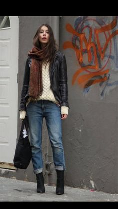 Black boots (use ankle boots), bag, leather jacket; white or cream sweater; boyfriend jeans; earthy red and brown scarf