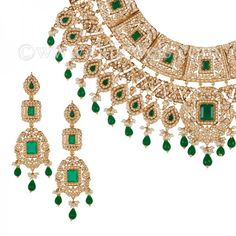 Grand #choker #necklace with long #drop #earrings and matching #tikka (4 pieces), studded with #pearls and #emerald stones in 22 karat yellow #gold, crafted on adjustable #dori with ruby and emerald tassel. https://www.rajjewels.com/22-k-pearl-emerald-bridal-choker-set.html#sthash.sY8AjHYy.dpuf