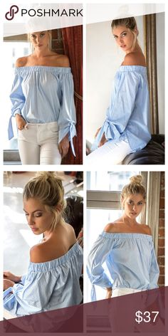 Blue And White Striped Off-Shoulder Top Blue and white striped off-shoulder top has elastic gathering around shoulders, ties at ends of sleeves, and a rounded hem that can be worn in or out of pants or skirt. EVIEcarche Tops