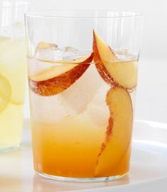 Two parts club soda, one part sweet apricot nectar, plus sliced nectarines to nibble. Another great idea: combine club soda with puréed watermelon.