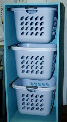 Laundry Basket Hamper.  Gliding brackets hold laundry baskets and allow for easy roll-out access. Perfect for sorting and transportation. (Because unlike my current sorting bags, these won't rip.)