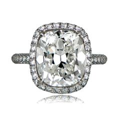 A beautiful 5 Carat Estate Engagement Ring that features a lovely antique cushion cut diamond.