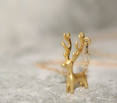 Hey, I found this really awesome Etsy listing at https://www.etsy.com/uk/listing/256490711/matte-gold-christmas-reindeer-necklace
