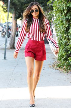 Glee star Naya Rivera rocks a bold look in red short shorts & a striped button up, complemented by browline aviators