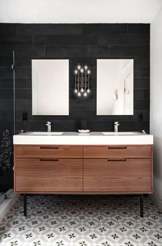 Transitional Bathroom by Toronto Interior Designers & Decorators Shirley Meisels. The floor provides graphical and femininity. The stringent tiles and sink enlightens the wood and provide contrast to the feminine.