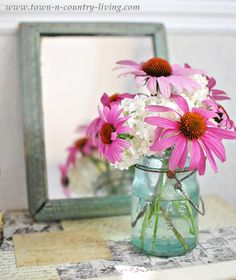 Summer flower arrangement of Queen Anne's Lace and Coneflower via Town and Country Living