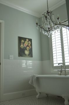 wall color, subway tile, chandy, and vintage oil painting...