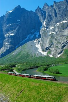 The Rauma train passes by the mighty Trollveggen, which juts 1,000 feet up. ©…