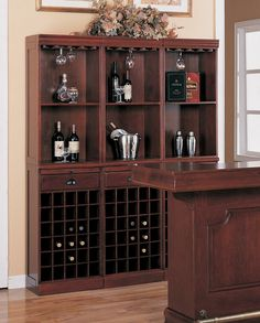 "Home bar unit 3 shelf wall wine unit Louis Phillipe style cherry finish wood with wine bottle and glass storage.  This set features a stylish Louis Phillipe style with open shelves , wine racks, and glass racks on the top shelf.   Comes in separate pieces top and bottom, this set includes 3 base units and 3 top units.  Each unit measures 20"" x 13""x 75.5"" H.  Some assembly required."
