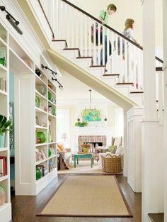 So open and bright. Love the staircase/bridge.