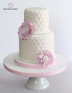 Modern embossed, textured Ivory Wedding Cake with pink accents. #weddingcake #modernwedding #ivorywedding #moderncake #elegantcake