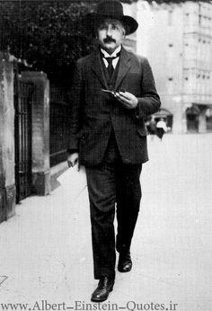Albert Einstein walking with pipe in hand