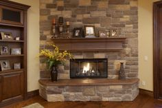 Indoor fireplace with stone veneer wall face.