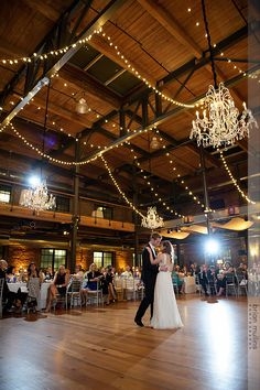 First Dance!  Under Get Lit, Special Event Lighting crystal chandeliers in Bay 7, American Tobacco Campus.  Planner: A Southern Soiree.  Photo: Brian Mullins Photography.
