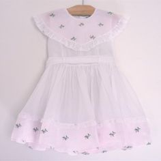 Vintage rose organdy toddler dress with embroidery, circa 1950's.