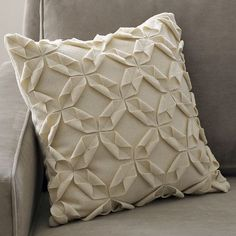 i think i could make something like this felt origami pillow cover by west elm.