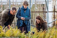 Catherine, Duchess of Cambridge, officially unveils her RHS Back to Nature Garden at the Chelsea Flower Show 2019 alongside landscape architects Andrée Davies and Adam White of Davies White. The garden includes forget-me-nots, in memory of Princess Diana.