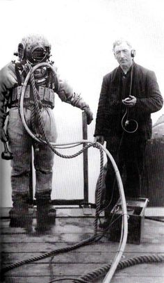 Diver, Calvin Hart and Tender, Mark Haley, from the Anchor Line Dock, working on an intake pipe in the bay (May 20, 1908)