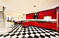 Black, white, and red kitchen with tiled floor