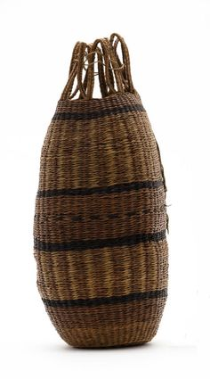 Africa | Small cylindrical basket made of plant fibre, with a drawstring at the top | ca. 1962