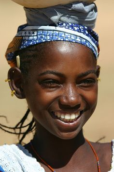 Gorgeous little girl from Mali. Stunning smile.