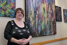 Dana Markestein shows off her paintings at the Cedar Hill Recreation Centre Thursday. Thirty-four pieces of Markestein