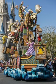 Tangled Float- Festival of Fantasy Parade<-- OH MY GOSH my family was the Grand Marshals in this parade yesterday! I can hardly believe it!!!!