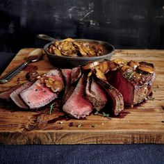 London Broil with Mushroom Sauce | MyRecipes.com London broil actually refers to a cooking method rather than the specific cut (top round or flank steak).