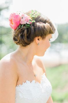 Bridal updo with peonies and ranunculus: http://www.stylemepretty.com/georgia-weddings/douglasville/2015/03/20/whimsical-georgia-summer-wedding/ | Photography: Rustic White - http://www.rusticwhite.com/