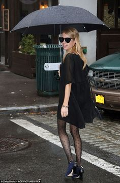Emma Roberts looked incredible in her semi-sheer LBD and polka dot tights as she stepped out in New York City on Monday