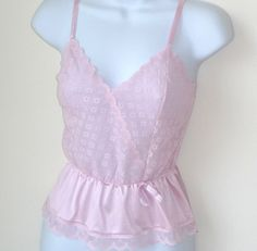 Pale pink 1980s Warners Angelique sheer floral on netting bodice camisole, size small.  Adjustable satin straps; faux cross over bodice, V neck and peplum waist panel; floral scalloped lace edging details.  For sale at paroliro on ETSY, $18.00 [Please click on image for full details, 4 more photo views and exact measurements.]  Thanks for looking!