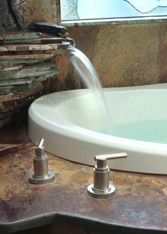 Water fall faucet - can someone please make a recycling water fall faucet for everyday bathtubs??? My water bill is crazy.