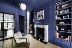 Living room with Critall screen and double-height slot window. Photography: Gautier Houba