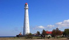 Tahkuna Lighthouse (Estonian: Tahkuna Tuletorn) - a lighthouse located in the Tahkuna Peninsula, Hiiu Parish, on the island of Hiiumaa; in Estonia.    The const... Get more information about the Tahkuna Lighthouse on Hostelman.com #attraction #Estonia #landmark #travel #destinations #tips #packing #ideas #budget #trips #lighthouse