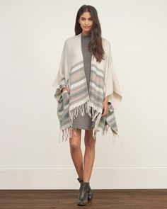 Womens Patterned Blanket Poncho   The free-spirited blanket poncho is comfortable with a non-closure silhouette, detailed with pretty pattern and front pockets, finished with fringe hem, Easy Fit   Abercrombie.com