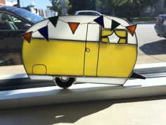 A personal favorite from my Etsy shop https://www.etsy.com/listing/253204806/camper-trailer-rv-stained-glass