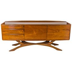 An exceptionally rare sideboard by Scottish manufacturer, Beithcraft. Produced as part of the 'The Organic Range.' This piece is beautifully handcrafted in teak and in very good condition.  https://www.1stdibs.com/furniture/storage-case-pieces/sideboards/late-1970s-scottish-beithcraft-sideboard/id-f_2315383/