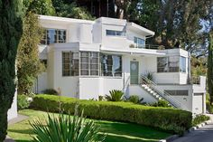 Sreamline Moderne, wsj: The exterior of the 1937 house, designed by architect William Kesling in the Streamline Moderne style, included porthole windows, second-floor observation deck and gangplank front steps. #Architecture #Streamline_Modern