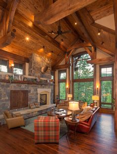 Aspen Wood Home rustic living room. The furniture is not sitting well with me lol, but I LOVE love love the high volumed ceilings and the color of the beautiful wood.