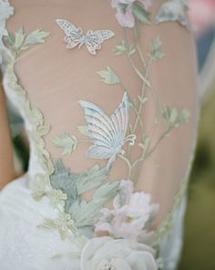 "A Cherry Blossom themed wedding on the MEG Wedding Jewelry blog. The ""Papillon"" wedding gown from Claire Pettibone."