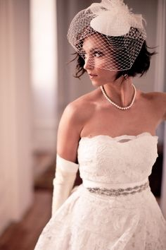 Vintage styled wedding dress with long white gloves and birdcage veil - love it! #weddingdress