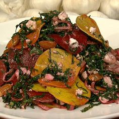 Michael Symon's Kale Salad with Shaved Beets, Feta & Toasted Almonds.  I might like to try this.