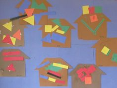 Construction paper gingerbread houses on the art board