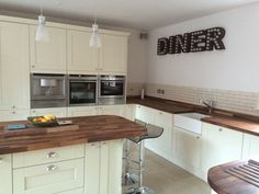 Wren Kitchens: Shaker Sage and Alabaster Timber - This was sent to us by one of our Kitchen Giveaway winners! What do you think to the 'Diner' light up sign? We think it gives a cool contrast to the traditional units. Very nice.