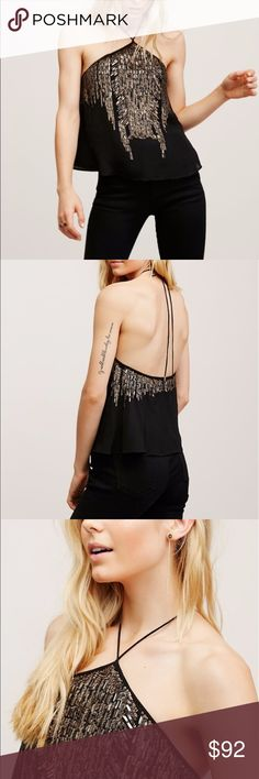 "NWOT Free people black embellished halter top Brand new without tags! Flowy halter top with tie closure at the neck and low dipping back for a sultry silhouette. Eye-catching embellishments and sparkling sequins cascade from the neckline around to the back. Lined.  Perfect for New Years!!  Shell: 100% Viscose Lining: 65% Viscose, 35% Cotton Hand Wash Cold Separately Import Bust: 36.5"" = 92.71 cm Length: 18"" = 45.72 cm Free People Tops"