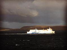 A NorthLink ferry sailing near Bressay Lighthouse on Bressay, the Shetland Islands, Scotland (Rachel Hazell, photographer)